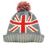 有在白色隔绝的英国国旗旗子的被编织的羊毛帽子 库存照片