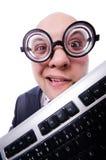 有在白色隔绝的键盘的滑稽的人 库存照片