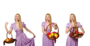 有在白色隔绝的水果篮的妇女 免版税库存照片