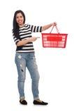 有在白色隔绝的购物车的妇女 免版税库存图片