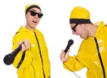 有在白色隔绝的mic的滑稽的执行者 免版税库存图片