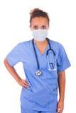 有在白色backgro和听诊器的年轻医生隔绝的面具 免版税图库摄影