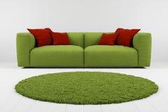 有地毯特写镜头的绿色沙发 皇族释放例证