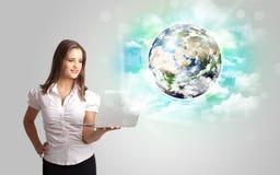 有地球和云彩概念的少妇 免版税库存图片