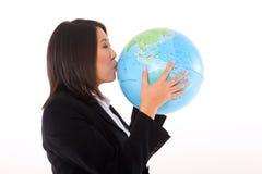有地球的亚裔女实业家 免版税库存照片