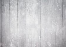有垂直的浅灰色的木墙壁镶边的 库存图片