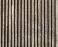 有垂直线和条纹的织地不很细模铸混凝土墙壁 库存图片