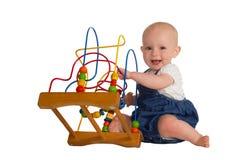 有培训玩具的愉快的婴孩 库存图片