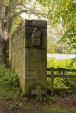 有基督徒标志的石墙 库存照片