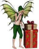 有堆的圣诞节神仙的矮子男孩礼物 免版税库存照片