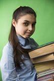 有堆的青少年的女孩书 免版税库存照片