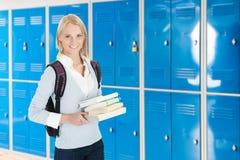 有堆的年轻女性大学生书 免版税库存图片