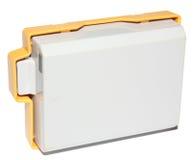有塑料保护的照相机电池 库存图片