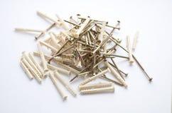 有塑料定缝销钉的螺丝 库存照片