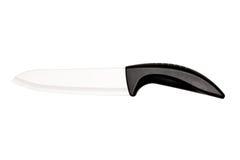 有塑料把柄的大厨刀在白色背景 免版税图库摄影