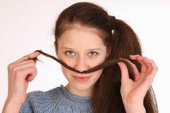 有壮观的头发的美丽的女孩 免版税库存照片