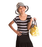 有夏天帽子和提包的II女孩 免版税库存照片