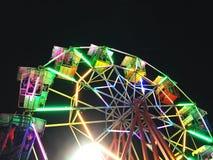 有夜光的弗累斯大转轮在黑背景 免版税库存图片