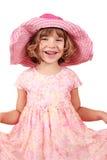 有大帽子的愉快的小女孩 免版税库存图片