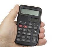 有大数字的小计算器在手中在白色 免版税库存图片
