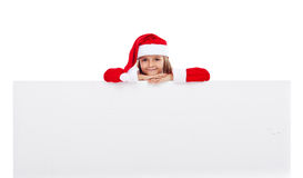 有大横幅的小圣诞老人女孩 免版税库存照片
