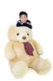 有大熊玩偶的亚裔男孩 库存照片