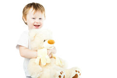 有大玩具熊的逗人喜爱的滑稽的婴儿女婴 免版税库存照片