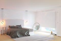 有大窗口和砖墙的新的舒适卧室 图库摄影