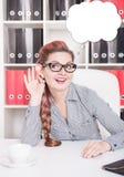 有大耳朵的微笑的女商人窃听 免版税图库摄影