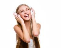 有大耳机的女孩在头 库存照片