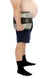 有大腹部的外形人站立与标度 免版税库存图片