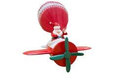 有大袋子的圣诞老人玩偶在飞机 免版税库存图片