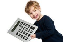 有大计算器的逗人喜爱的男孩 免版税库存图片