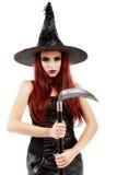 有大镰刀的年轻巫婆 免版税库存照片