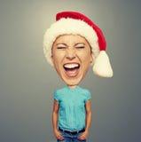 有大头的激动的圣诞老人女孩 免版税库存图片
