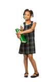 有大绿皮书的聪明的女孩 免版税库存照片