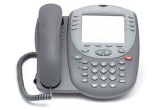 有大LCD屏幕的现代办公系统电话 隔绝在wh 免版税库存照片