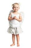 有天使的逗人喜爱的小女孩飞过在白色 免版税库存图片