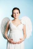 有天使翼的孕妇 库存照片
