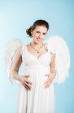 有天使翼的孕妇 图库摄影