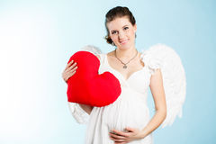 有天使翼的孕妇 免版税库存图片