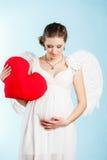 有天使翼的孕妇 免版税库存照片