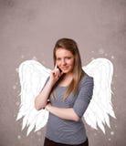 有天使被说明的翼的逗人喜爱的人 免版税库存照片
