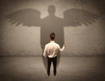 有天使阴影概念的诚实的推销员 免版税库存照片