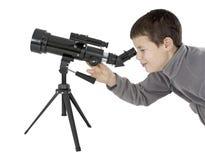 有天文望远镜的年轻人 图库摄影