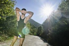 有太阳火光的赛跑者温暖的腿 库存图片