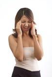 有头疼的妇女或偏头痛或者重点 免版税库存照片
