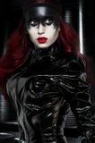 有奇怪的黑构成的红发妇女 库存照片