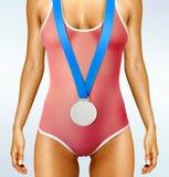有奖牌的美好的妇女身体 库存图片