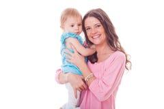 有女儿的愉快的母亲 免版税库存图片